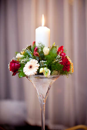 Wedding table flowers and candel in glass candlestick  Stock Photo - 16364202