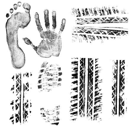 Black ink foot, hand, shoe sole, car and bike tire tread prints  Isolated objects at white background  photo