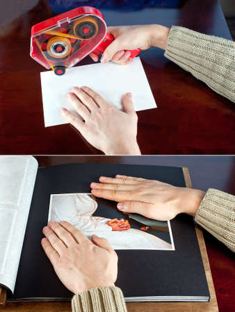 putting in: pasting photos to an album  Putting glue at photo  Photo glue gun in use  Stock Photo