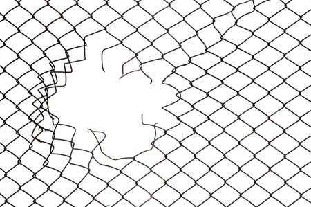 hole in the wire mesh fence at white background Archivio Fotografico