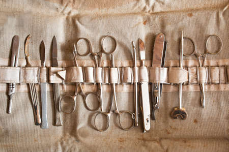 Set of old, vintage surgical instruments  scalpel, scissors,  clamp  Standard-Bild