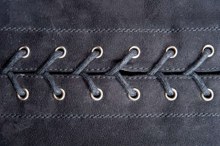 lacing: Lacing of two pieces of black fabric