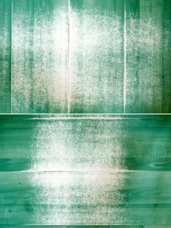 attrition: grunge style green panels background    Attrition, discolored at floor panels surface  Stock Photo
