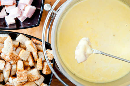 Fork over cheese fondue pot