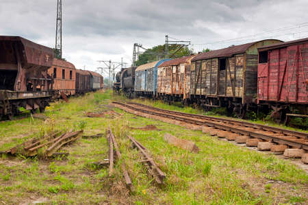 Abandoned old railway wagons at station
