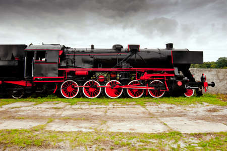 Side view of old black, steam locomotive photo