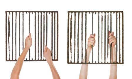 old bar: hands holding old, rusty prison grating  Isolated on white background  Stock Photo