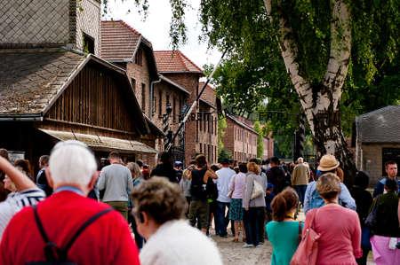 oswiecim: OSWIECIM, POLAND - August 27 2013  Tourists getting threw main gate of Concentration Camp in Auschwitz  August 27, 2013 in Oswiecim - Poland