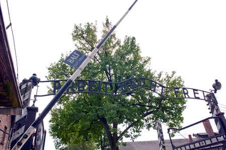 oswiecim: OSWIECIM, POLAND - August 27 2013  inscription  arbeit macht frei  at main entrance to Auschwitz german Concentration Camp in Poland  August 27, 2013 in Oswiecim - Poland  Editorial