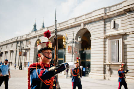 solemn: MADRID, SPAIN - OCTOBER 2  Female soldier marching in military parade  Solemn Changing of the Guard at the Royal Palace in Madrid October 2, 2013 in Madrid - Spain