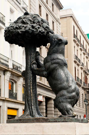 strawberry tree: Statue of bear and strawberry tree at Puerta del Sol square - symbol of Madrid Stock Photo