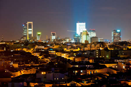 Panoramic night cityscape of business district of Madrid Standard-Bild