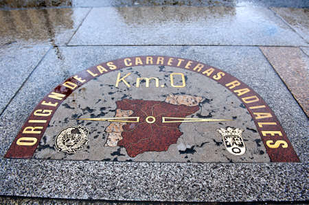plate with the designation of Spain center in Madrit at  Puerta del Sol square