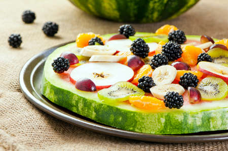 healthy fruit pizza concept - pizza made of watermelon and fruits photo