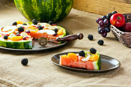 healthy fruit pizza concept - pizza made of watermelon and fruits