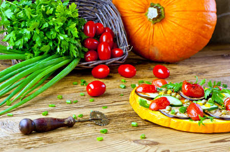 healthy vegetable pizza concept - pizza made of pumpkin and vegetables