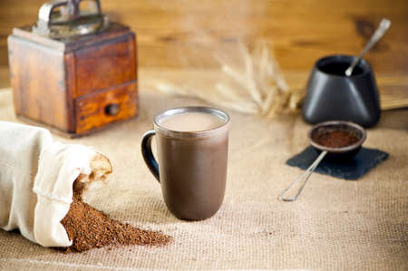 substitute: A mug of substitute coffee and  ears of rye at canvas Stock Photo