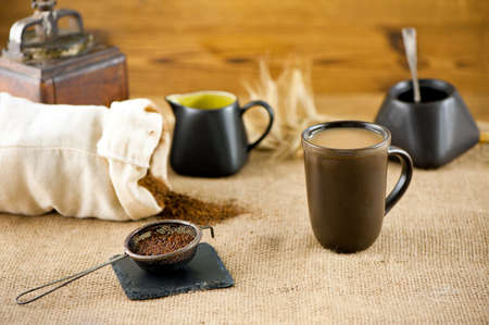 substitute: A mug of substitute coffee with milk and  ears of rye at canvas Stock Photo
