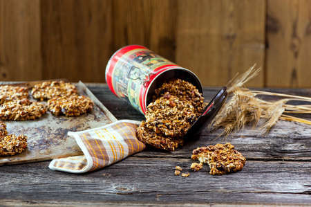 healthy Oatmeal cookies in container on the wooden table photo