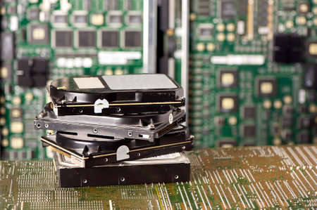 hard disk drive: pile of hard drives and motherboard