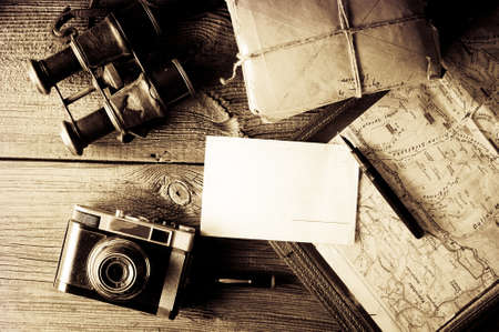 antique: letter from travel concept - old mapholder, camera and binoculars with vignette