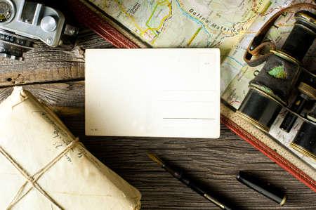 Vintage postcard, suitcase, pen and letters photo