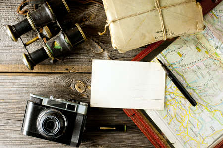 letter from travel concept - old map holder, camera and binoculars
