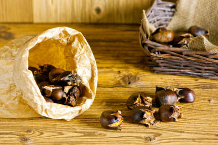 baked sweet chestnuts in paper bag