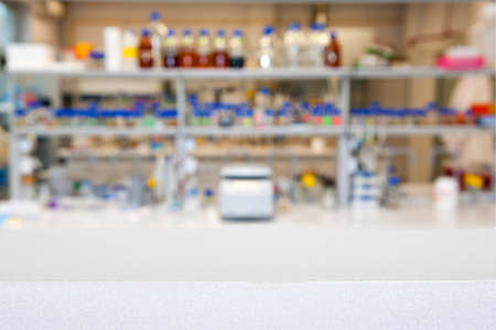research facilities: empty laboratory top or bench against blurred laboratory