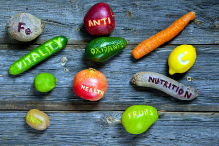 scattered fruits and vegetables with cut words - healthy lifestyle concept Banco de Imagens