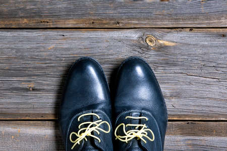 italian leather shoes concept: boots laced with spaghetti Banco de Imagens