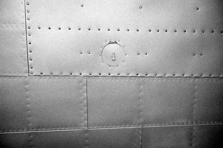 steel sheet: Grained black and white military metal plates with rivets Stock Photo