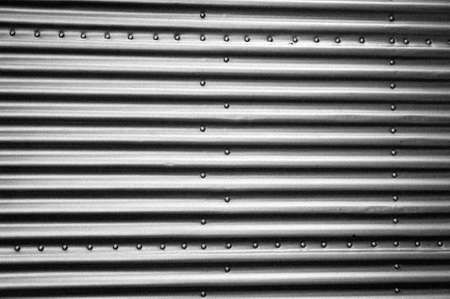aircraft rivets: grained black and white industrial metal plates with rivets Stock Photo