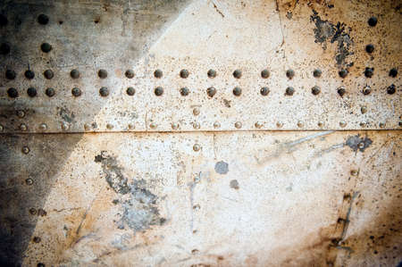 rivets: grained abstract industrial metal plates with rivets