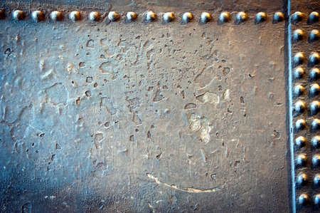 grained abstract industrial metal plates with rivets