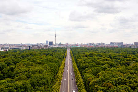 brandenburg: view of main street  17th of June Street  Strae des 17. Juni   and Berlin city: tv tower, Brandenburg gate, reichstag, Tiergarten and cathedral dome Stock Photo