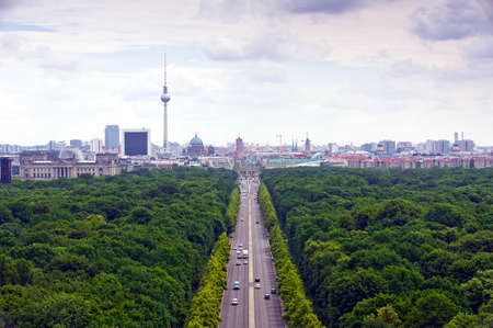 17th: view of main street  17th of June Street  Strae des 17. Juni   and Berlin city: tv tower, Brandenburg gate, reichstag, Tiergarten and cathedral dome Stock Photo
