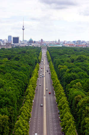 main gate: view of main street  17th of June Street  Strae des 17. Juni   and Berlin city: tv tower, Brandenburg gate, reichstag, Tiergarten and cathedral dome Stock Photo
