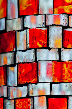 irregular: multicolored stained glass with irregular square block pattern Stock Photo