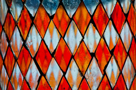 multicolored: detail of multicolored stained glass with irregular diamond block pattern