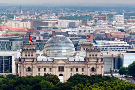 in copula: reichstag with german and european union flags in Berlin