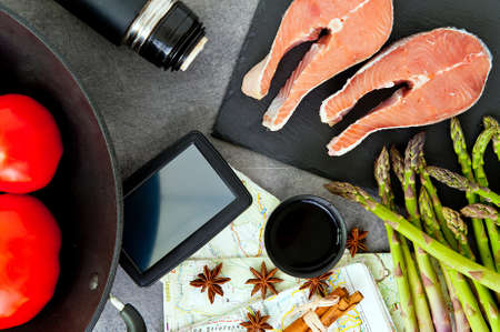culinary tourism: traveling and cooking concept. International cuisine set: map, thermos and food ingredients