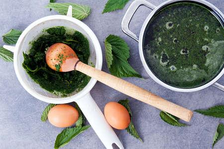 making vegetarian, healthy nettle soup Stock Photo