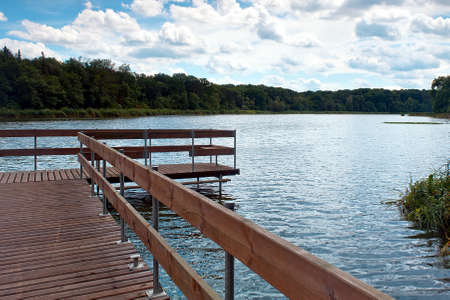 wooden bridge over lake and boat Stock Photo