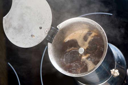brewing coffee in moka pot