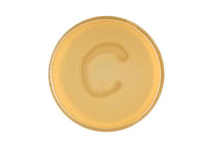 Alphabet made of bacteria escherichia coli culture on LB agar plate - letter c