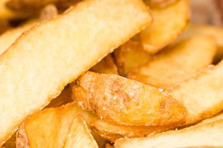 Close up of fried potato wedges Stock Photo