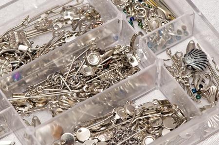 Box full of jewelry accessories
