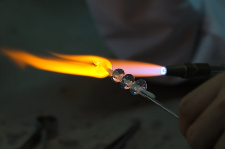 Shaping glass in fire