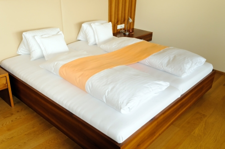 Modern wooden double bed shot in hotel